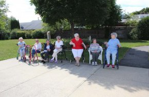 Residents enjoy sitting on outside bench